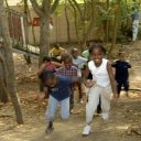 Young people playing at the Evergreen Adventure Playground in Dalston, London to mark Playday 2006.    Media contact :  Lisa Mangan Forster Company 020 7403 2230    Photographer : Howard.Davies 01273 208741